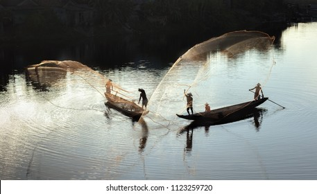 Fishermen throw a fishing nets. Vietnam. Hue city. Bridge survey. Morning