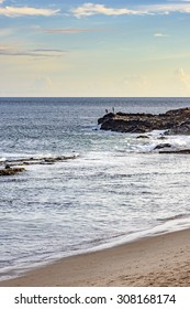 Fishermen unturned in the Bay of All Saints, near the lighthouse of Barra in Salvador city