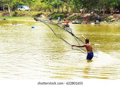 Fishermen use nets to catch fish