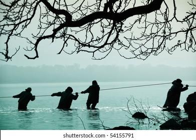 Fishermen in the water