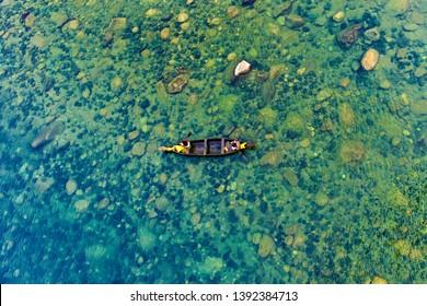 Fishermen's boat over clear waters of Umngot river, Meghalaya