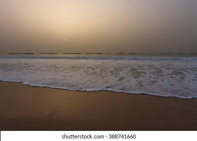Fishermen's boats in the Atlantic ocean, in Nouakchott, Mauritania (at sunset)