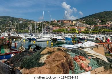 Fishermen's nets dry in the sun in the marina of Lerici, La Spezia, Liguria, Italy