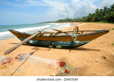 fishers boat on sand of coastline at sunny day