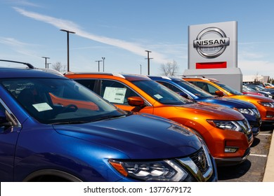 Fishers - Circa April 2019: New vehicles at a Nissan Car and SUV Dealership. Nissan is part of the Renault Nissan Alliance II