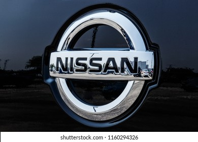 Fishers - Circa August 2018: Logo and Signage of a Nissan Car and SUV Dealership. Nissan is part of the Renault–Nissan Alliance VI