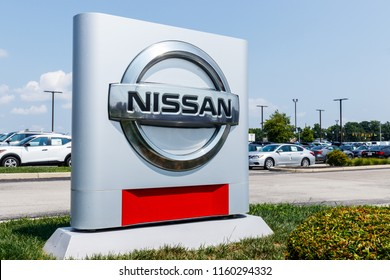 Fishers - Circa August 2018: Logo and Signage of a Nissan Car and SUV Dealership. Nissan is part of the Renault–Nissan Alliance V