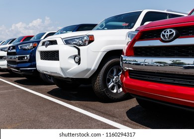 Fishers - Circa August 2018: New vehicles on display at a Toyota Car and SUV dealership. Toyota is the fifth largest company in the world by revenue V