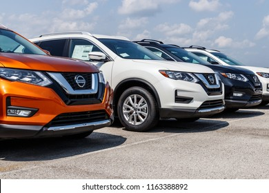 Fishers - Circa August 2018: New vehicles at a Nissan Car and SUV Dealership. Nissan is part of the Renault–Nissan Alliance VIII