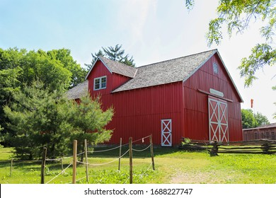 FISHERS, INDIANA, USA – MAY 28, 2018: A bright red barn in the green field in a day in summer