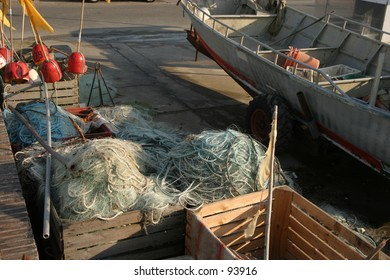 fishers' nets, boat and tools