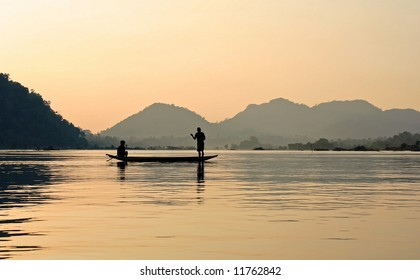 Fishers on Mekong with sunset