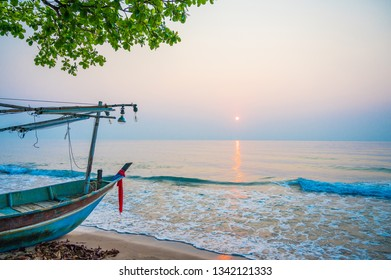 Fishery boat on the beach in sunrise