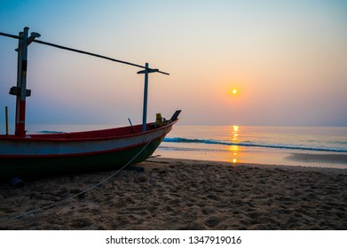 Fishery boat on the morning beach