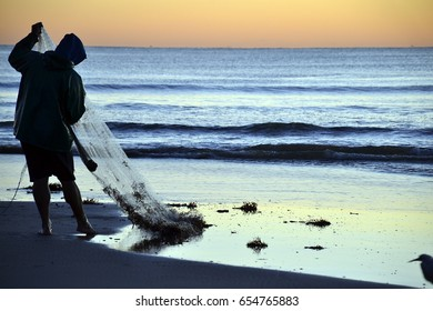 Fishery at sunrise, on the beach of Itapema Brazil South America