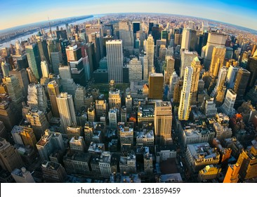 Fisheye aerial panoramic view over upper Manhattan, New York. Sunset of a clean, sunny day with exceptional visibility.