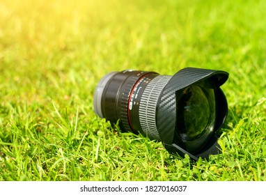 Fisheye camera lens on green grass