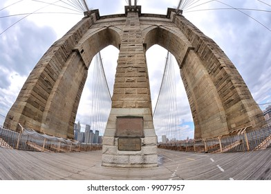fish-eye lens photo of Brooklyn Bridge pylon in New York City