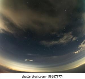 Fisheye look landscape view of a starry night sky