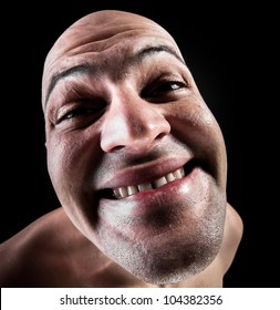 Fish-eye photo of huge male chin and idiot smile