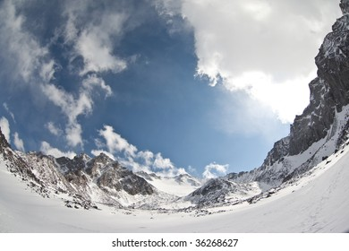 Fish-eye photo of winter Sayan mountains in Russian Federation