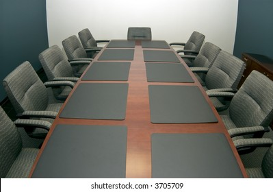 A fisheye shot of a small conference room vacant of activity with copy space available.