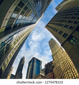 Fisheye view from down to top on the skyline buildings in New York