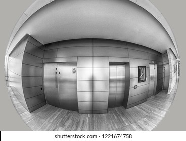 Fisheye view of elevator doors and corridor like a security peephole view giving the feeling something sinister happens here