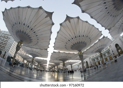 Fisheye view of giant umbrellas at Masjid Nabawi (Mosque) compound in Medina, Kingdom of Saudi Arabia. Nabawi mosque is the second holiest mosque in Islam.