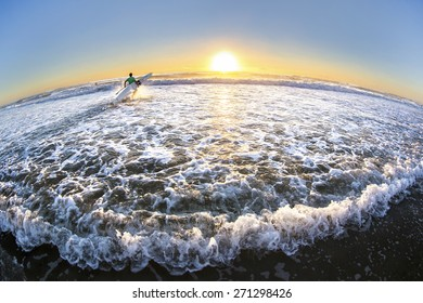 Fisheye view of Gold Coast Australia beach sunrise over ocean tide with surfer