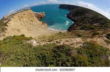 Fisheye view of ocean bay and Fortaleza de Belixe near Cabo de Sao Vicente Cape in the Algarve, Portugal