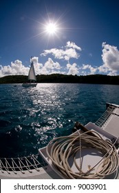 Fisheye view of a small sailboat in the Caribbean water taken from another boat