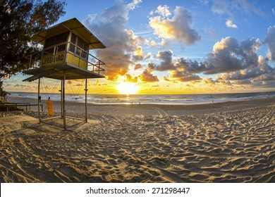 Fisheye view of Sunrise over Gold Coast Surfers Paradise beach with lifeguard station