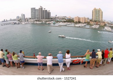A fish-eye, wide-angle view of downtown Miami and the Port of Miami as a cruise ship sails out.