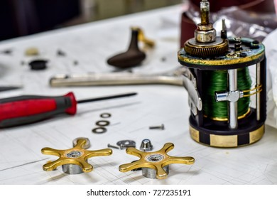 Fishhook and spare parts on white table