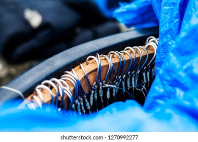 Fishhooks in a container ready for fishing
