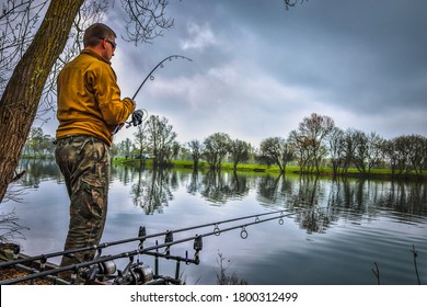 Fishing adventures, carp fishing. Angler is fishing with carp-fishing technique.