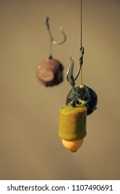 Fishing, angling. Fishhooks on line on blurred background. Hooks with fishing bait, chumming.
