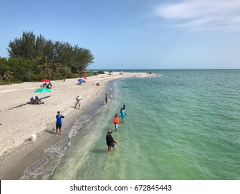 Fishing at the Blind Pass Beach, in Sanibel, island in Florida