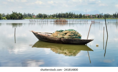 A fishing boat at anchor in the coastal waters of Hoi An, Vietnam