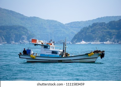 Fishing boat anchors in the bay near islands in South Korea.