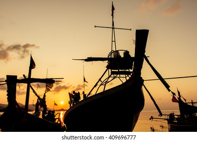 fishing boat at the beach sunset background