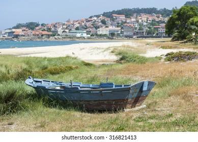 Fishing boat beached on the sand. Photo taken in Aldan, Cangas de Morrazo, Vigo estuary, Pontevedra, Spain