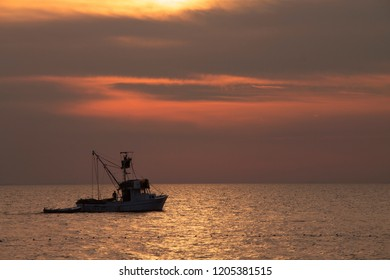Fishing boat at beautiful sunset , Croatia