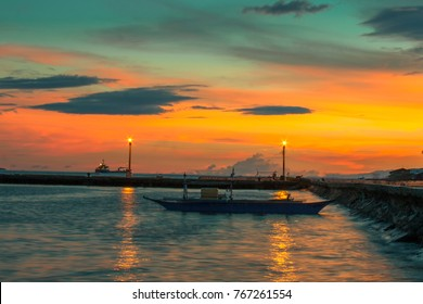 Fishing boat with beautiful sunset of Sta. Ana Wharf in Davao City Philippines