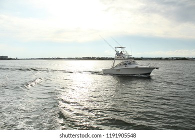 fishing boat with bright ocean sky