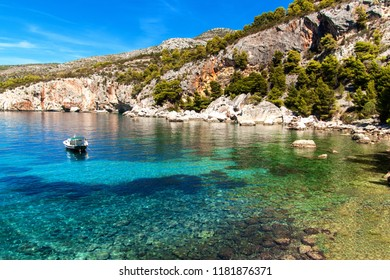 Fishing boat by the coast of Croatia. Fishing near the island of Hvar. Ship in the bay. Adriatic Sea Coast. Greetings from vacation