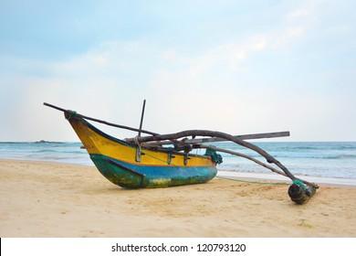Fishing boat by the shore at Bentota Beach, Sri Lanka
