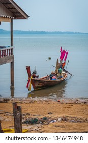 Fishing boat by the village on pillars, Koh Lanta, Thailand