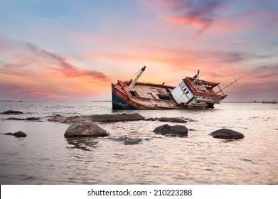 Fishing boat capsize sunset blackground